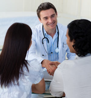 Doctor with couple